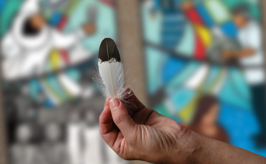 hand-eagle-feather